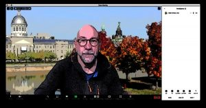 Adam in a Zoom call with his virtual background of a a park with imposing buildings